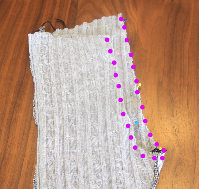 One leggings leg inside the other, with rainbow seam marked