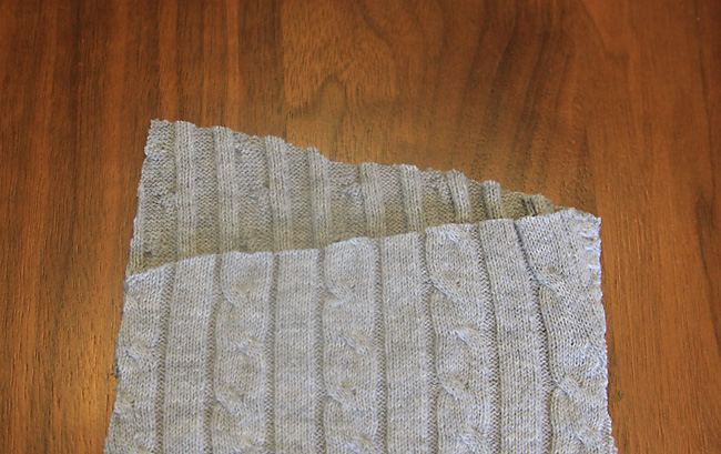 Closeup of sweater leggings pattern piece, showing back waistline is higher than the front