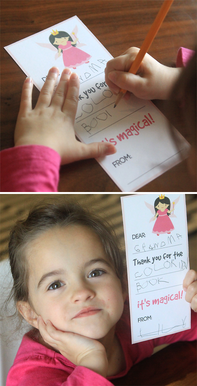Little girl with fill in the blank thank you note that has a fairy on it