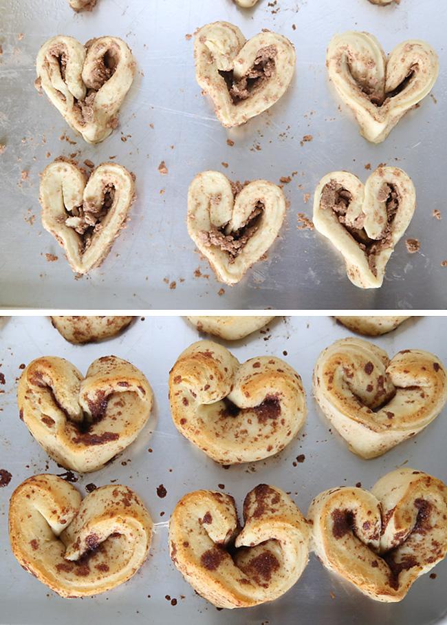 Cinnamon roll dough shaped into heart shape on a cookie sheet; baked heart cinnamon rolls