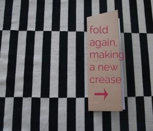 Presentation board folded again, making a new crease