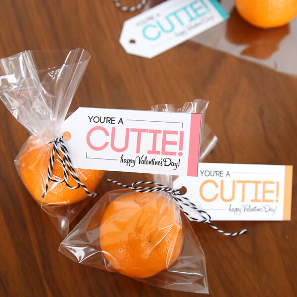 """Small oranges in a bags with a tag that says """"you're a cutie"""" for a healthy Valentines treat"""