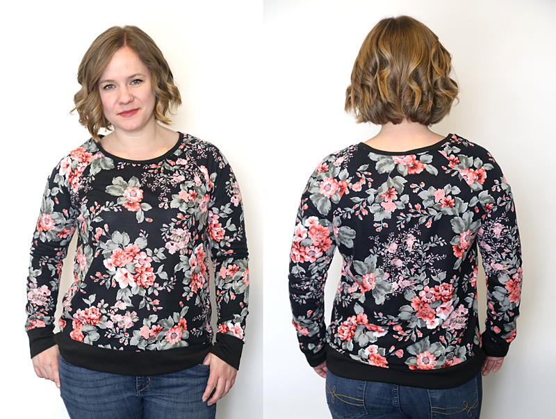 a woman wearing a floral sweatshirt made from a sewing pattern