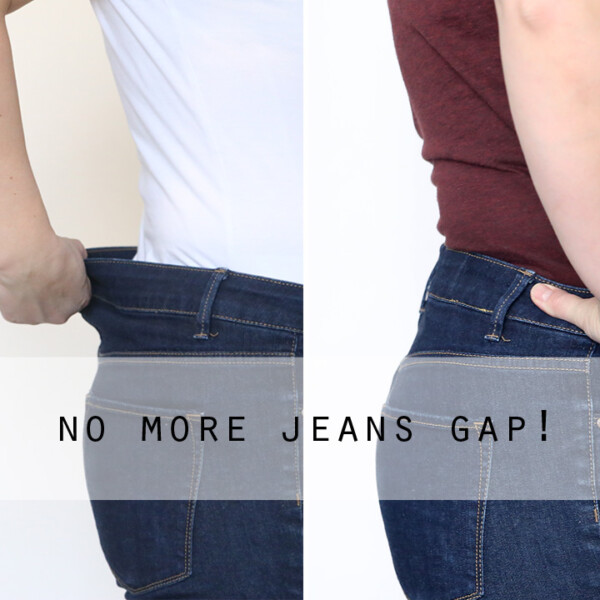 A woman showing a gap in the back waistband of her jeans
