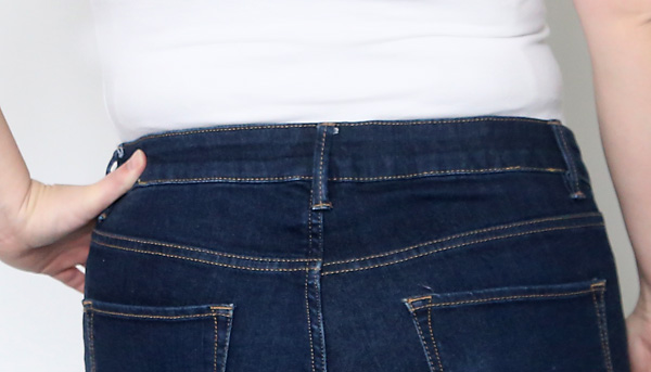 No more jeans gap! How to fix the waistband of your jeans so it doesn't gape in the back and show too much when you sit down. This is genius. Easy sewing tutorial.