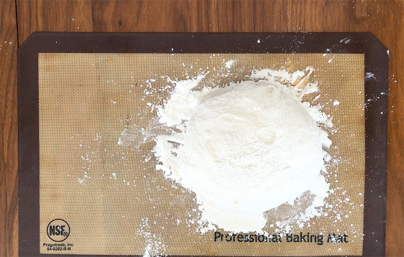 Bread dough turned out on floured surface