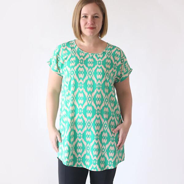 A woman wearing a green tunic top