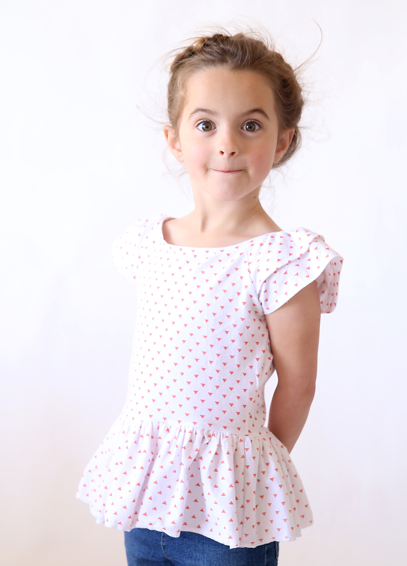 little girl wearing a polka dot shirt made from a free sewing pattern