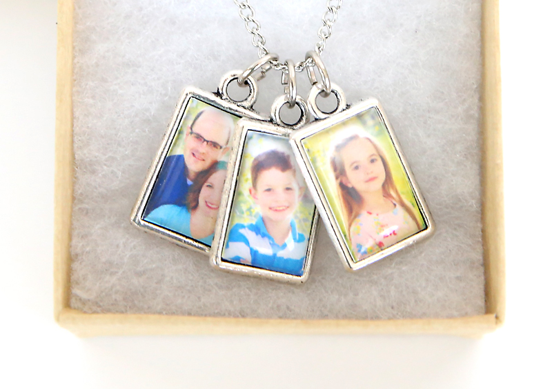 Three photo charms on a necklace