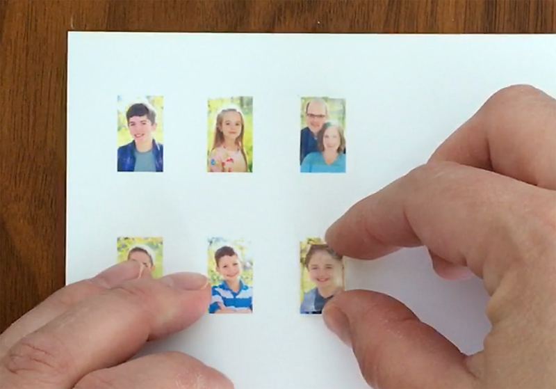 hands placing Klear-itz over small photo