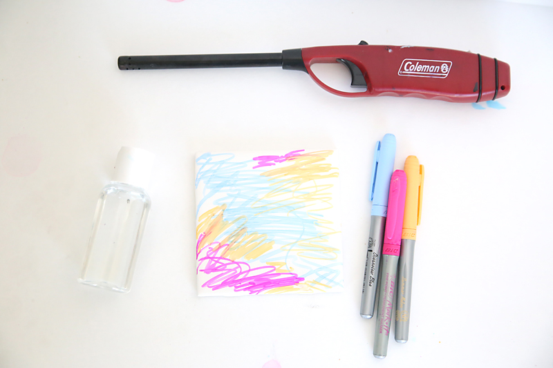 Fired art tiles supplies: tile with scribbles, permanent markers, alcohol, lighter