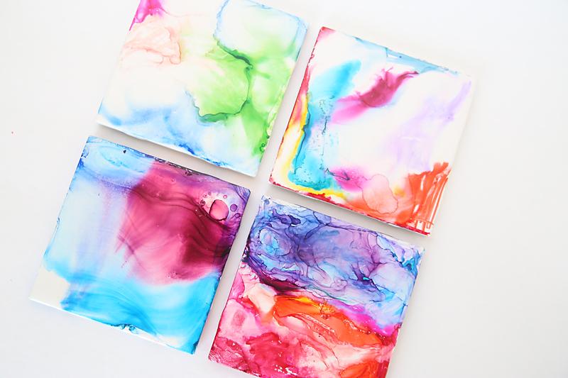 Four multicolored DIY art tiles