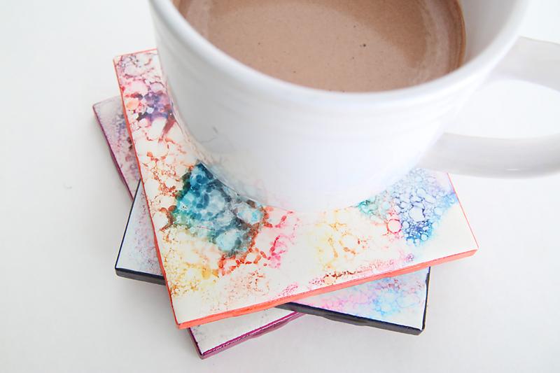 Stack of DIY coasters under a mug of cocoa