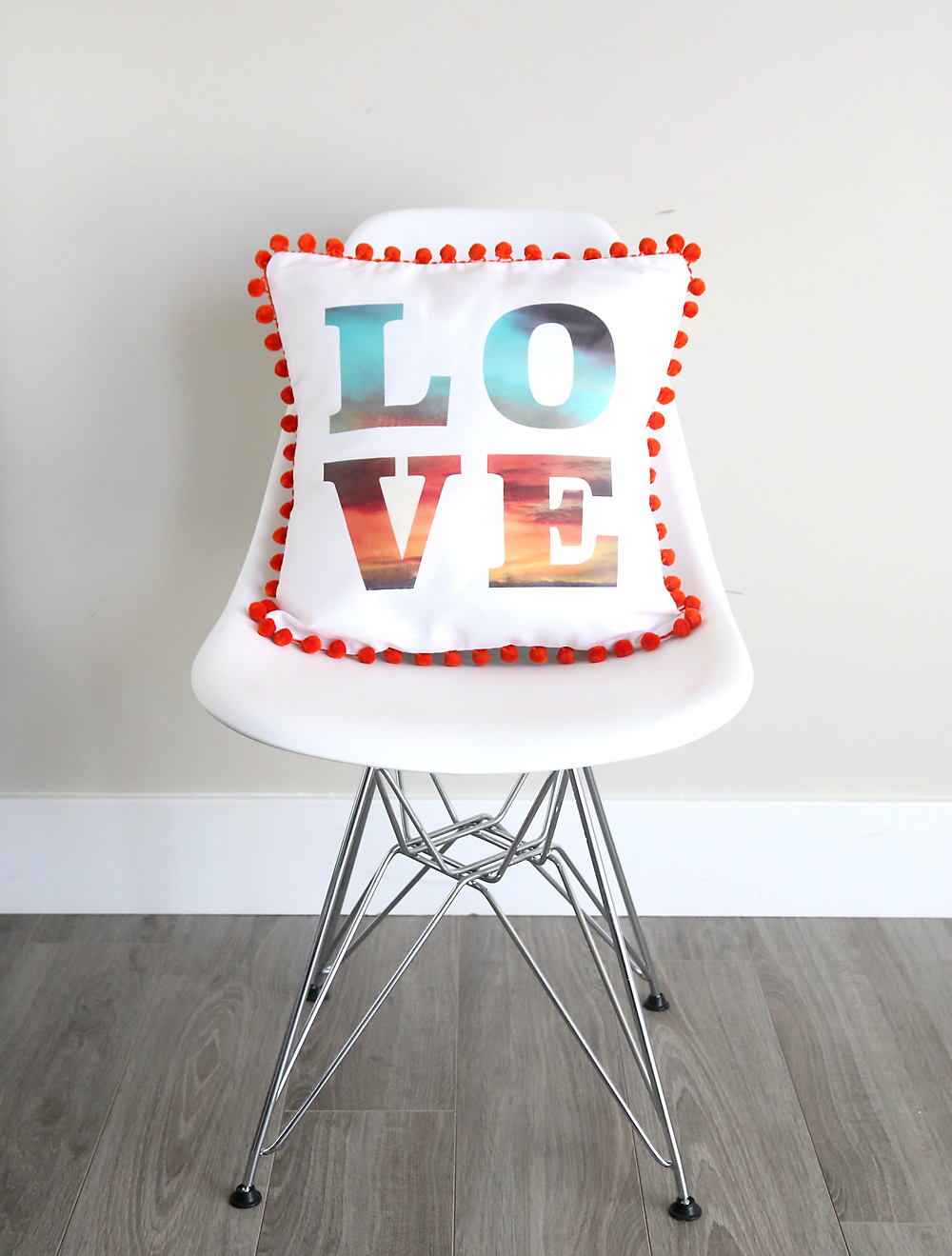 Text throw pillow on a chair