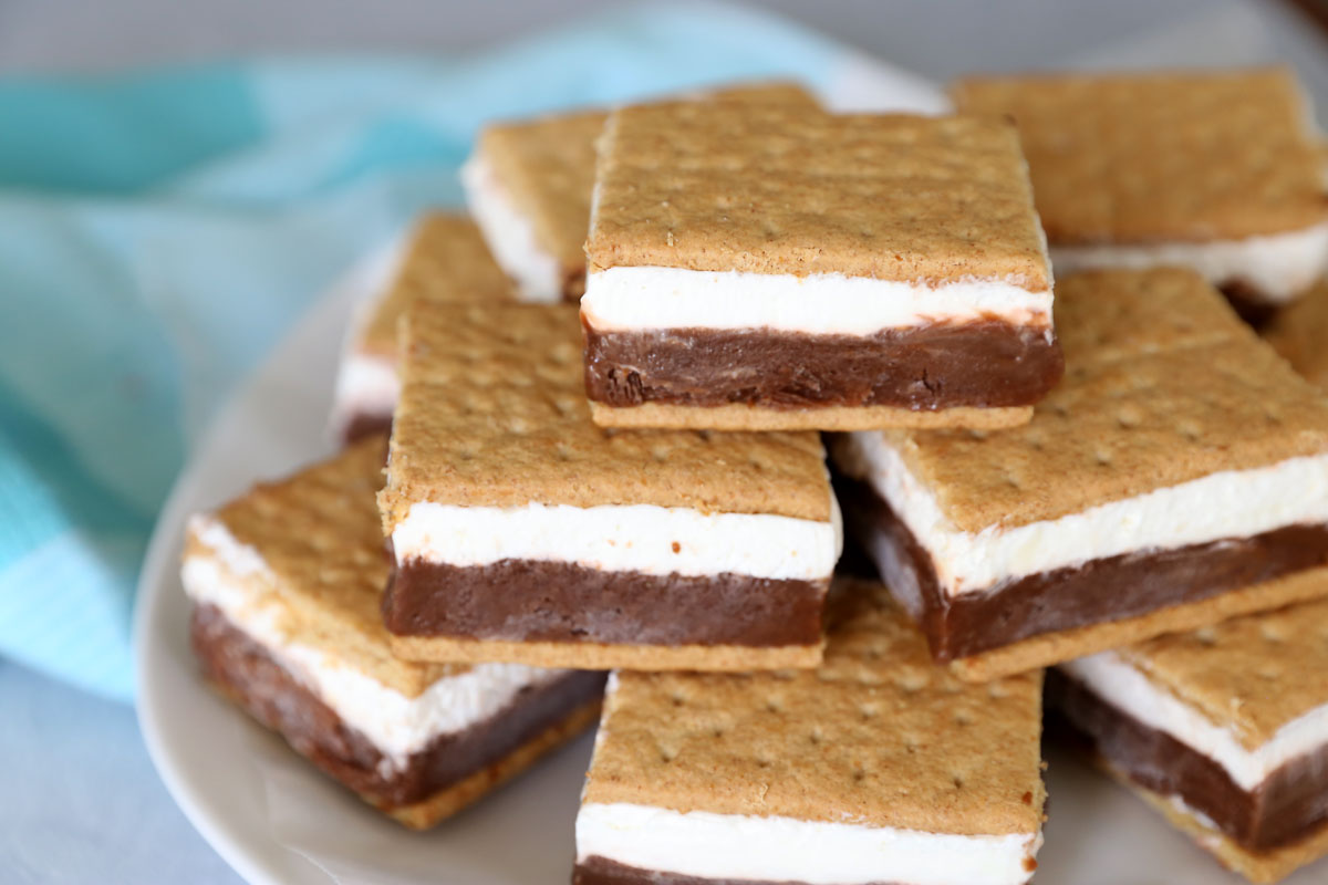 Frozen smores: layers of chocolate pudding and marshmallow creme sandwiched in between graham crackers and frozen!