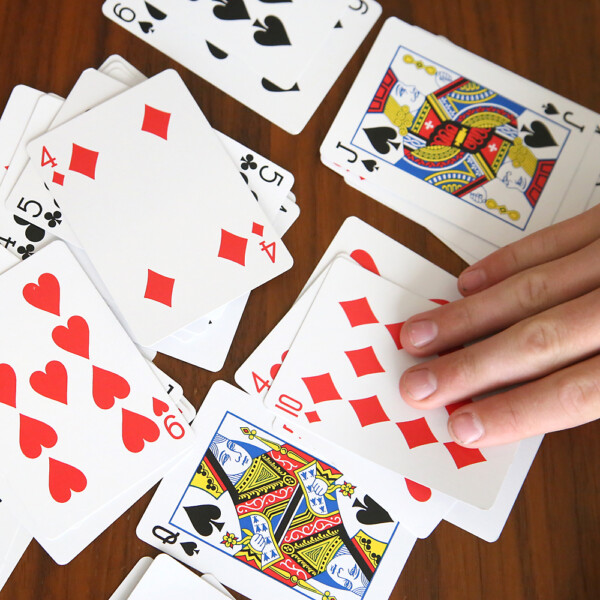 Hands and playing cards