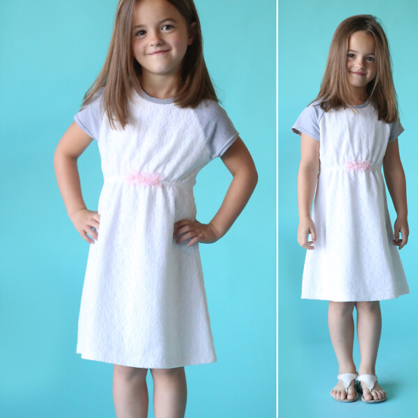 Little girl wearing a raglan sleeve play dress made from a sewing pattern