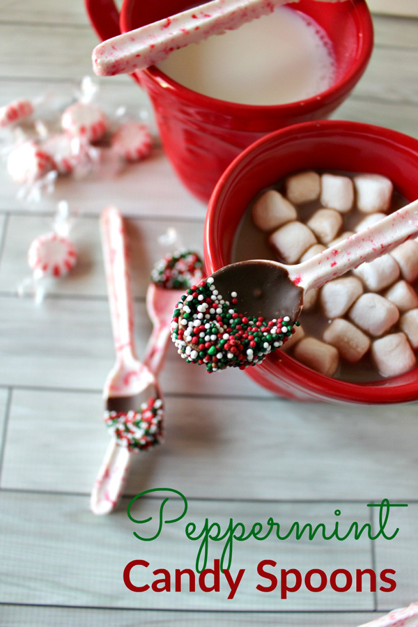 Spoons made from peppermint candy dipped in chocolate and sprinkles, with a cup of hot cocoa