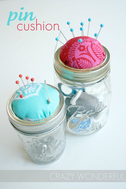 Mason jar sewing kit with sewing essential in the jar and pin cushion on the lid