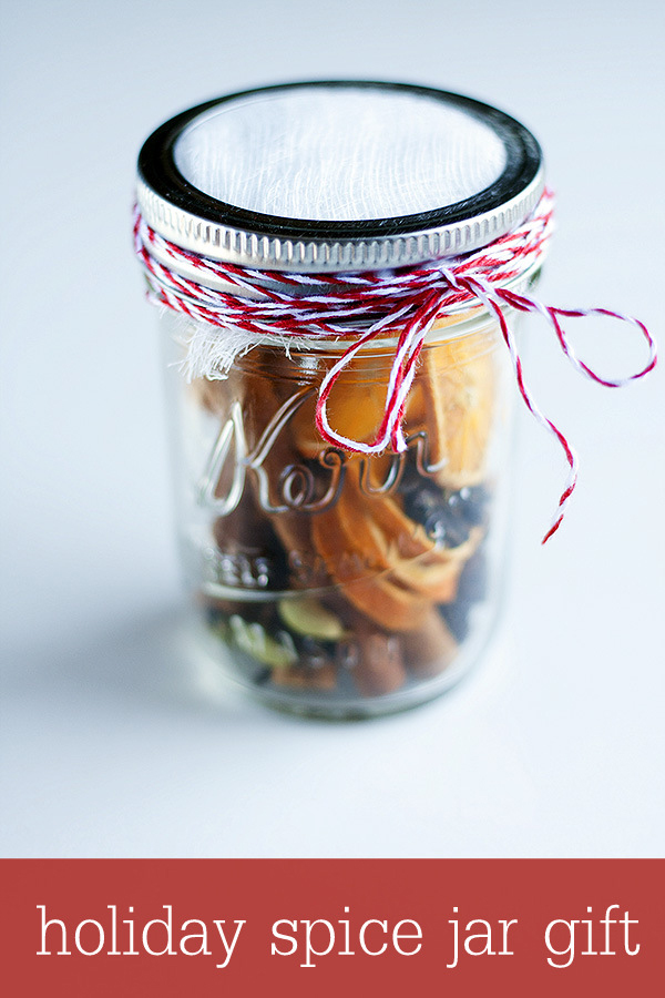 Christmas potpourri ingredients in a mason jar tied with twine