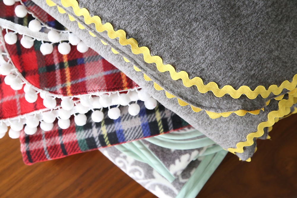 Three fleece blankets with different trims