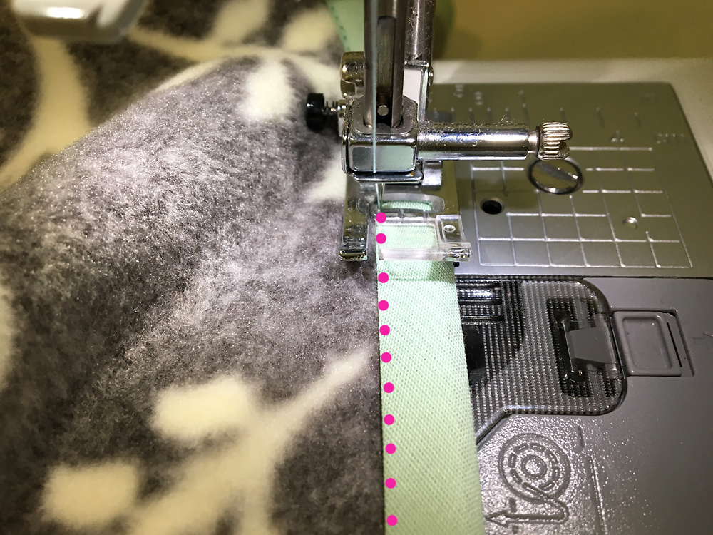 Fleece with bias tape over the edge on the sewing machine