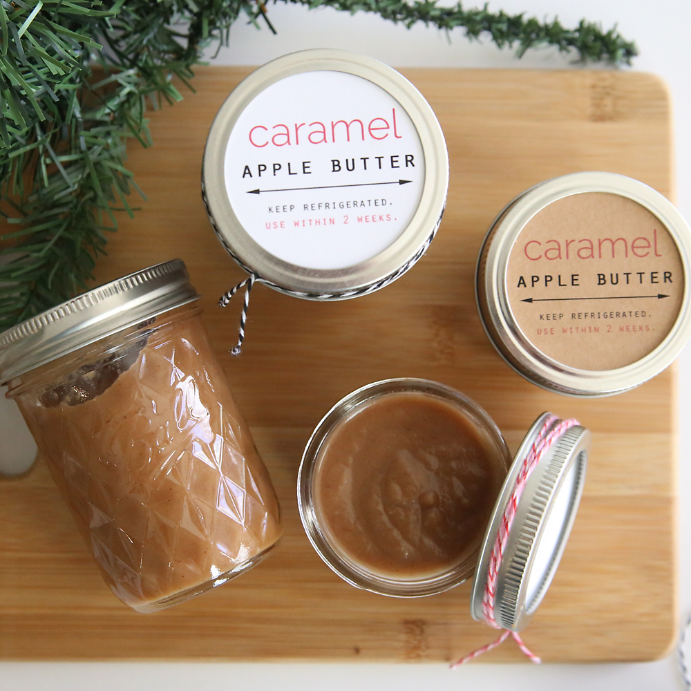 Caramel apple butter in small jars with gift tags