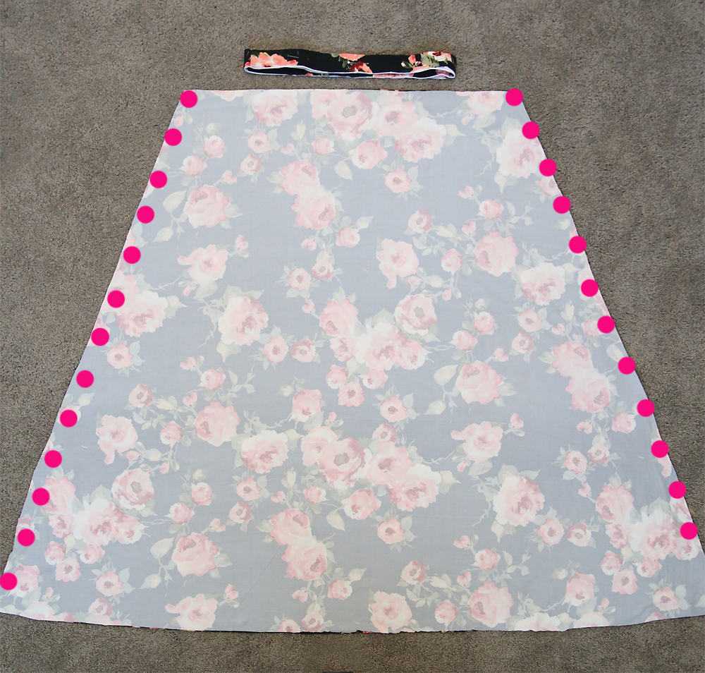 The skirt pieces of the dress laid right sides together, dots down each side to show side seams