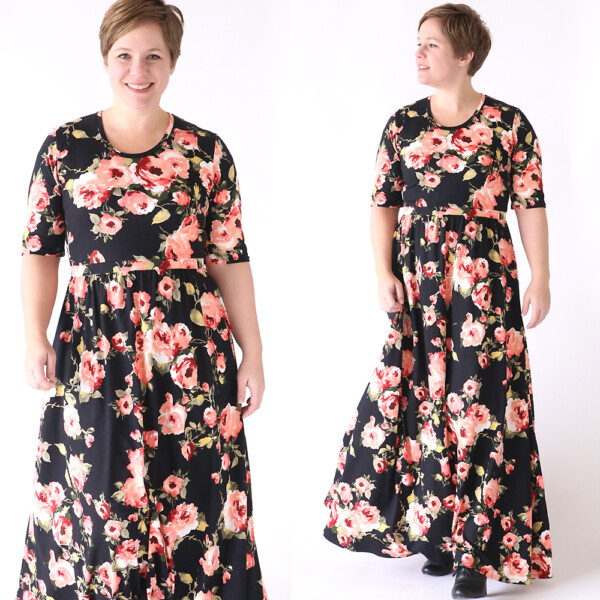 A woman wearing a long black floral maxi dress
