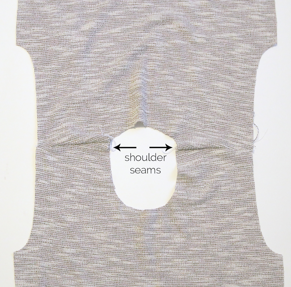 Sweatshirt front and back opened at the shoulder seams