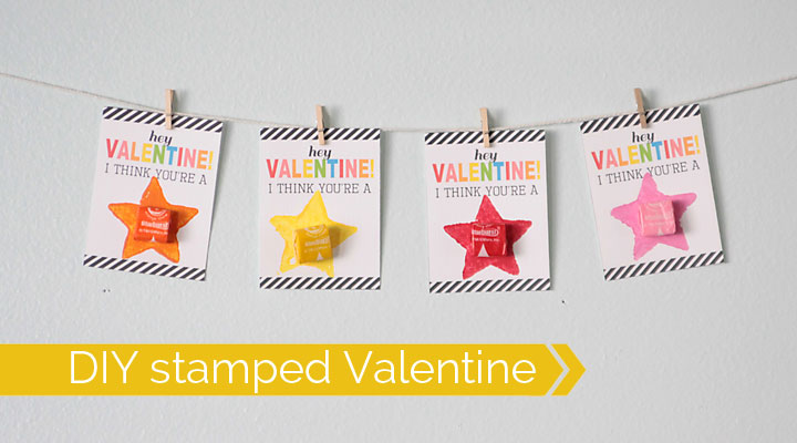 Valentine\'s Day Cards with starbursts candy hung on a line of string with mini clothespins