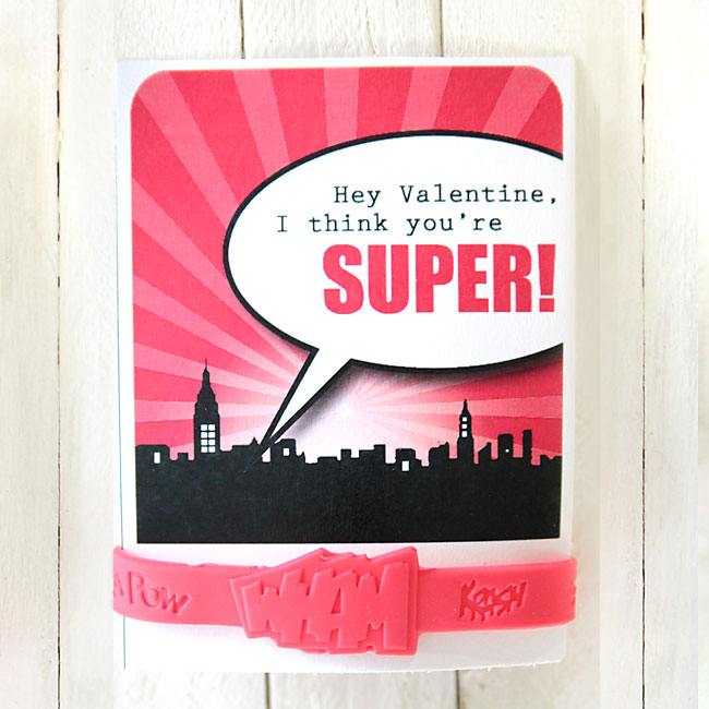 Valentine\'s day card that says: Hey Valentine, I think you\'re super! with a superhero bracelet