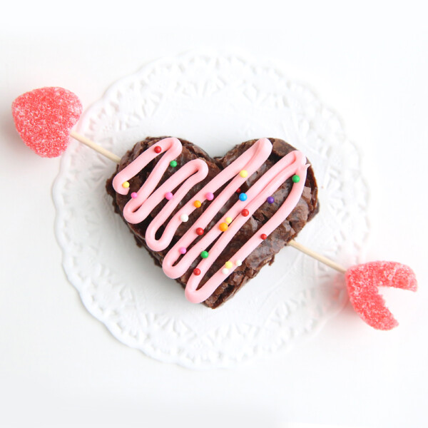 A heart brownie with an arrow through it made from toothpicks and jelly hearts
