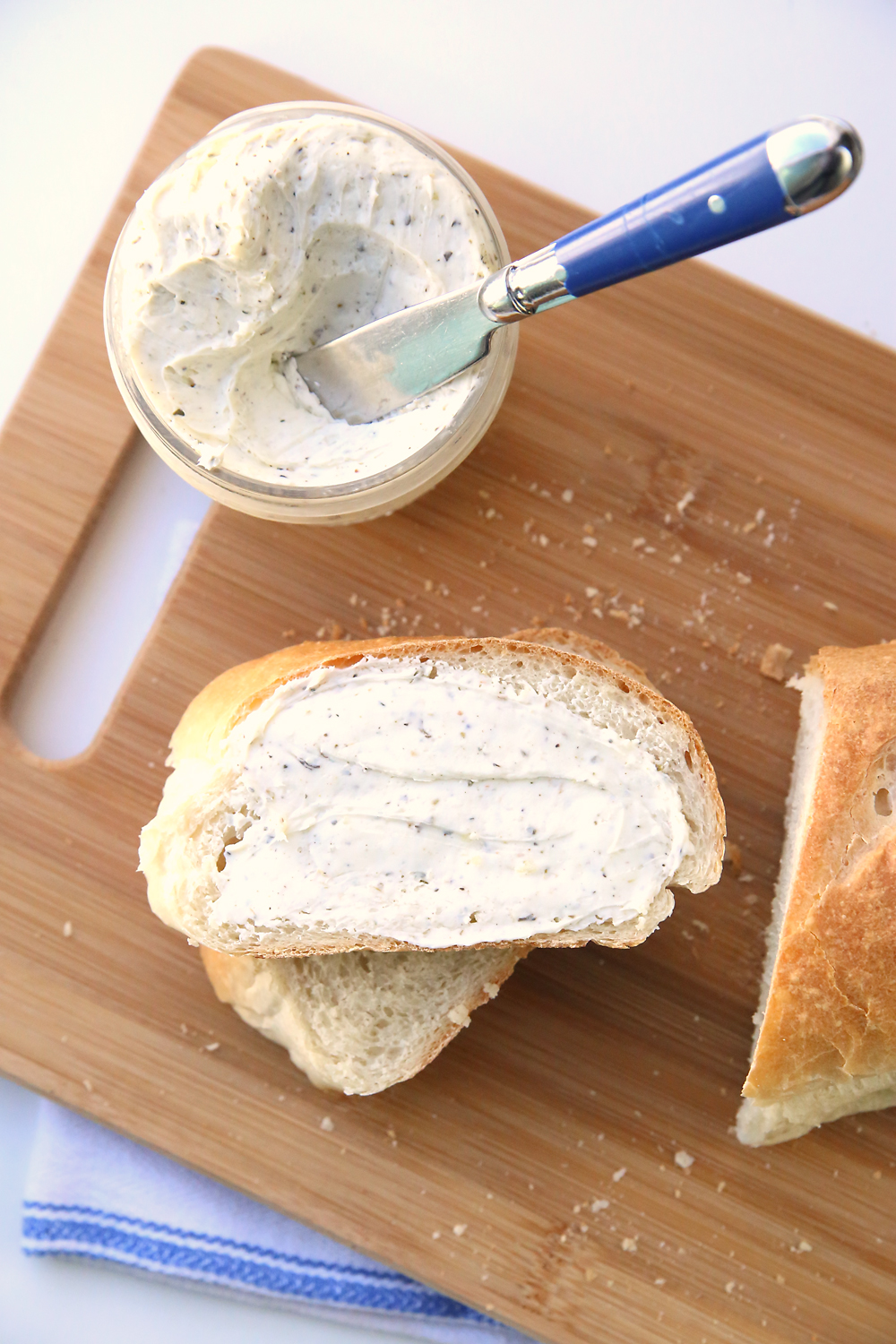 Learn how to make amazing homemade french bread with this easy recipe and video tutorial. It's so delicious! And try the herbed garlic butter too.