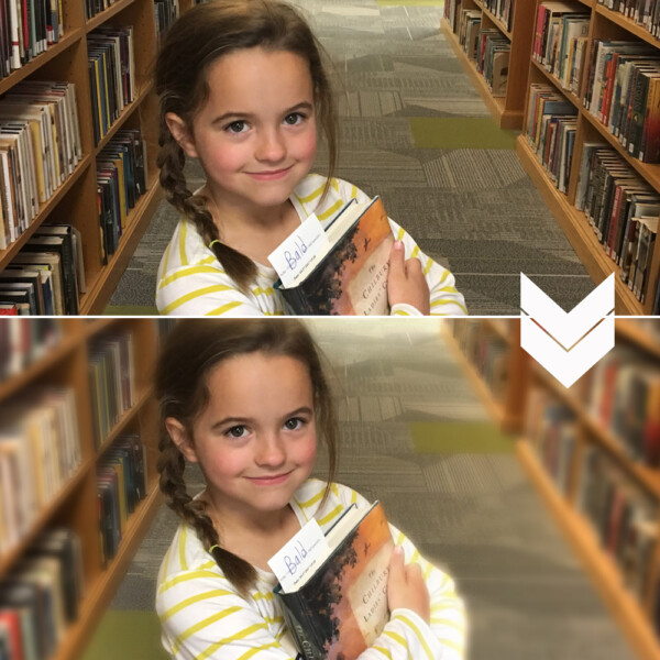 A little girl standing in a library; same photo with the background blurred