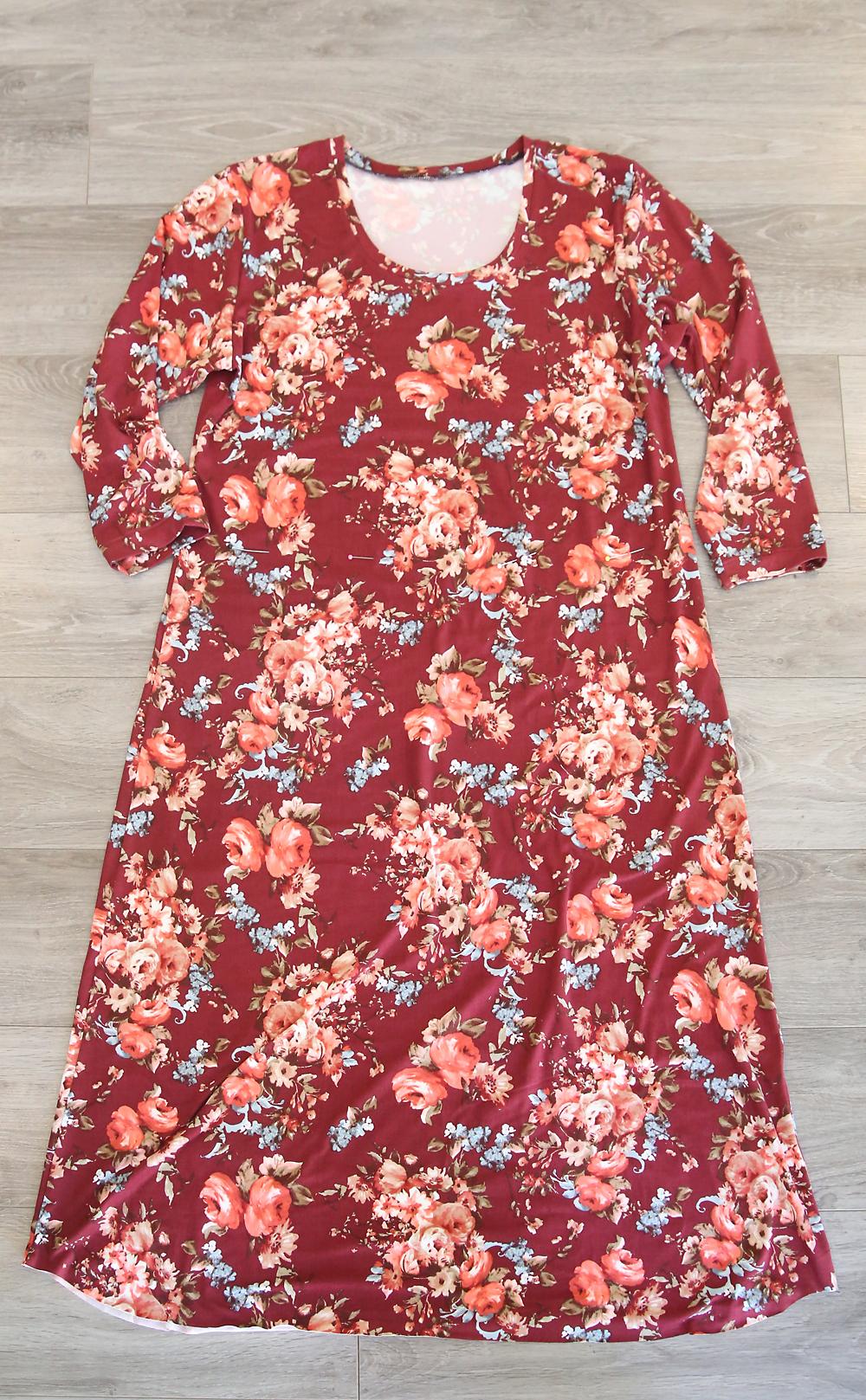 A midi length t-shirt dress laying on the floor