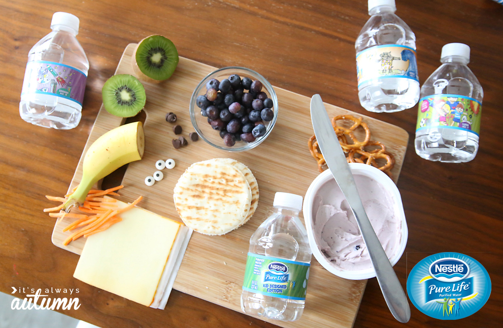 Supplies for silly snacks: pita bread, cheese, fruit, cream cheese, pretzels, candy eyes