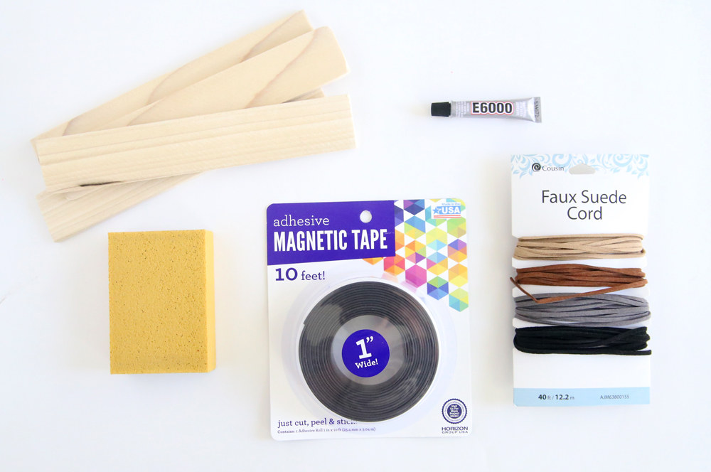 DIY frame supplies: wood slats, sanding block, magnetic tape, e6000 adhesive, faux leather cording