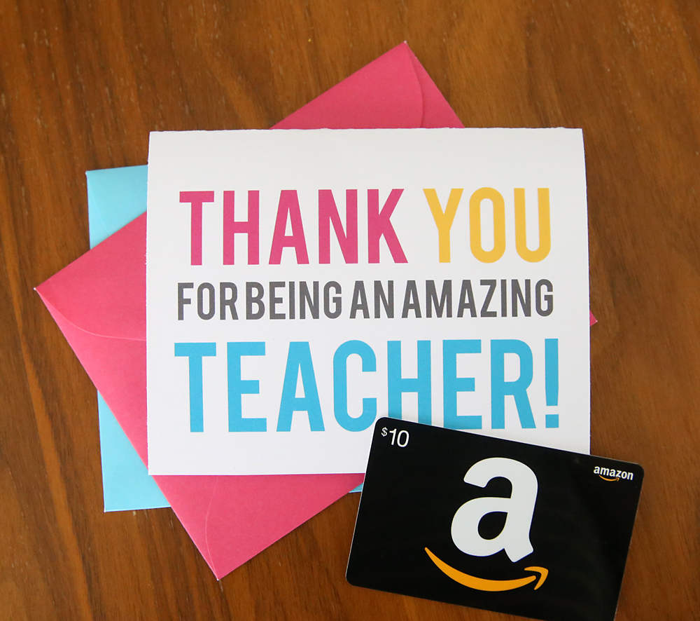 A close up of thank you card for a teacher and an amazon gift card