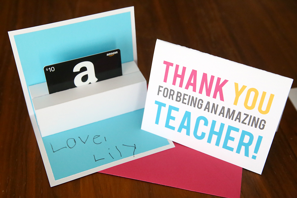A close up of a teacher appreciation card that holds a gift card that pops up when opened