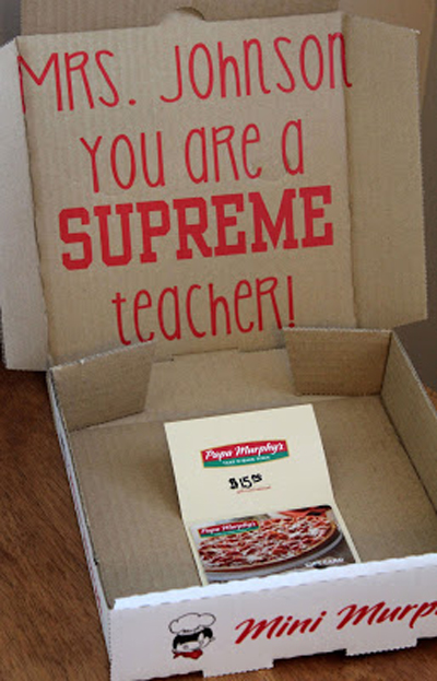 Opened pizza box that says you are a supreme teacher with gift card to pizza restaurant
