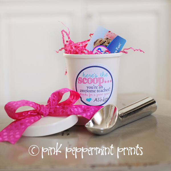 Ice cream container with gift card inside and ice cream scoop