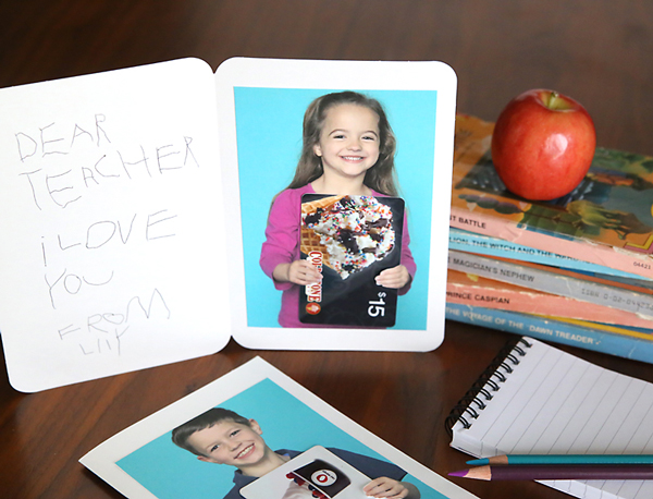 Card with photo of girl holding a gift card inside