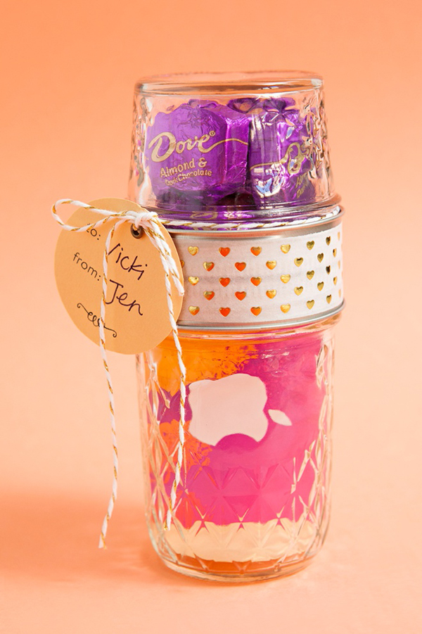 A jar with gift card and chocolates inside for teacher appreciation