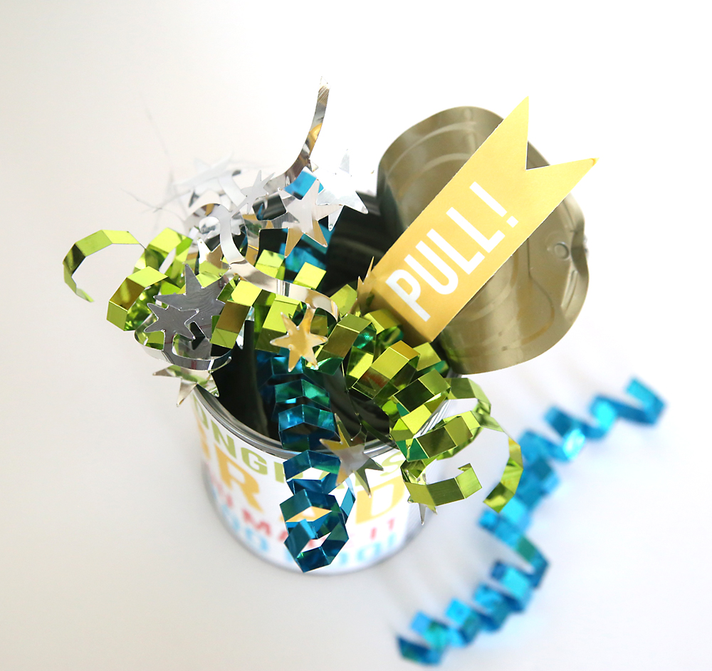 Cash in a can - fun way to give money as a gift for graduation, birthdays, or Father's Day. Give money inside a pop top can so the recipient can open the can and pull out a bunch of dollar bills taped together. Free printables for birthday, Father's day, or graduation.