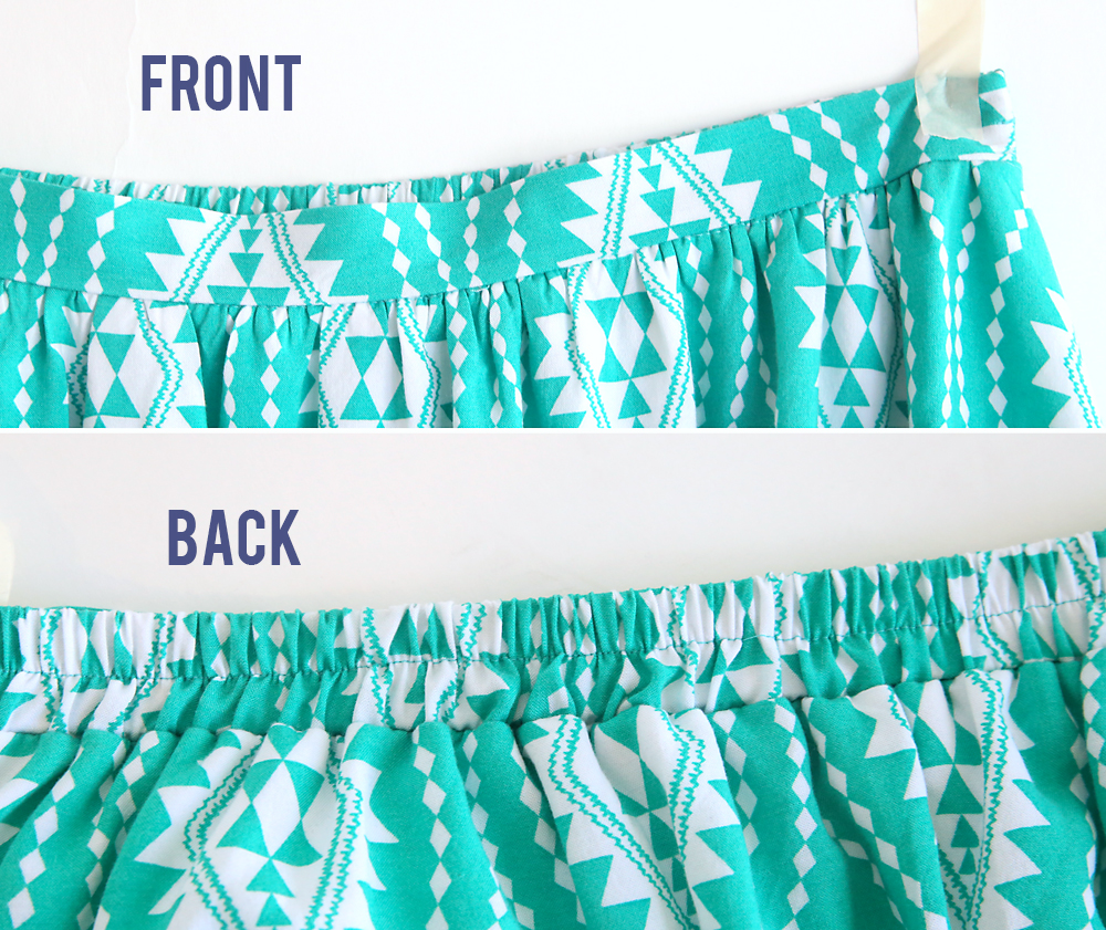 A close up of a skirt waistband, showing a flat waistband in the front and a gathered waistband in the back