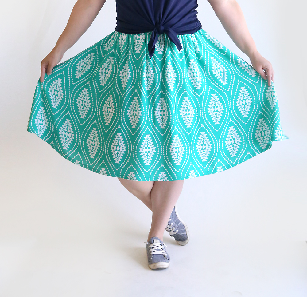 A woman holding her skirt to show it is full