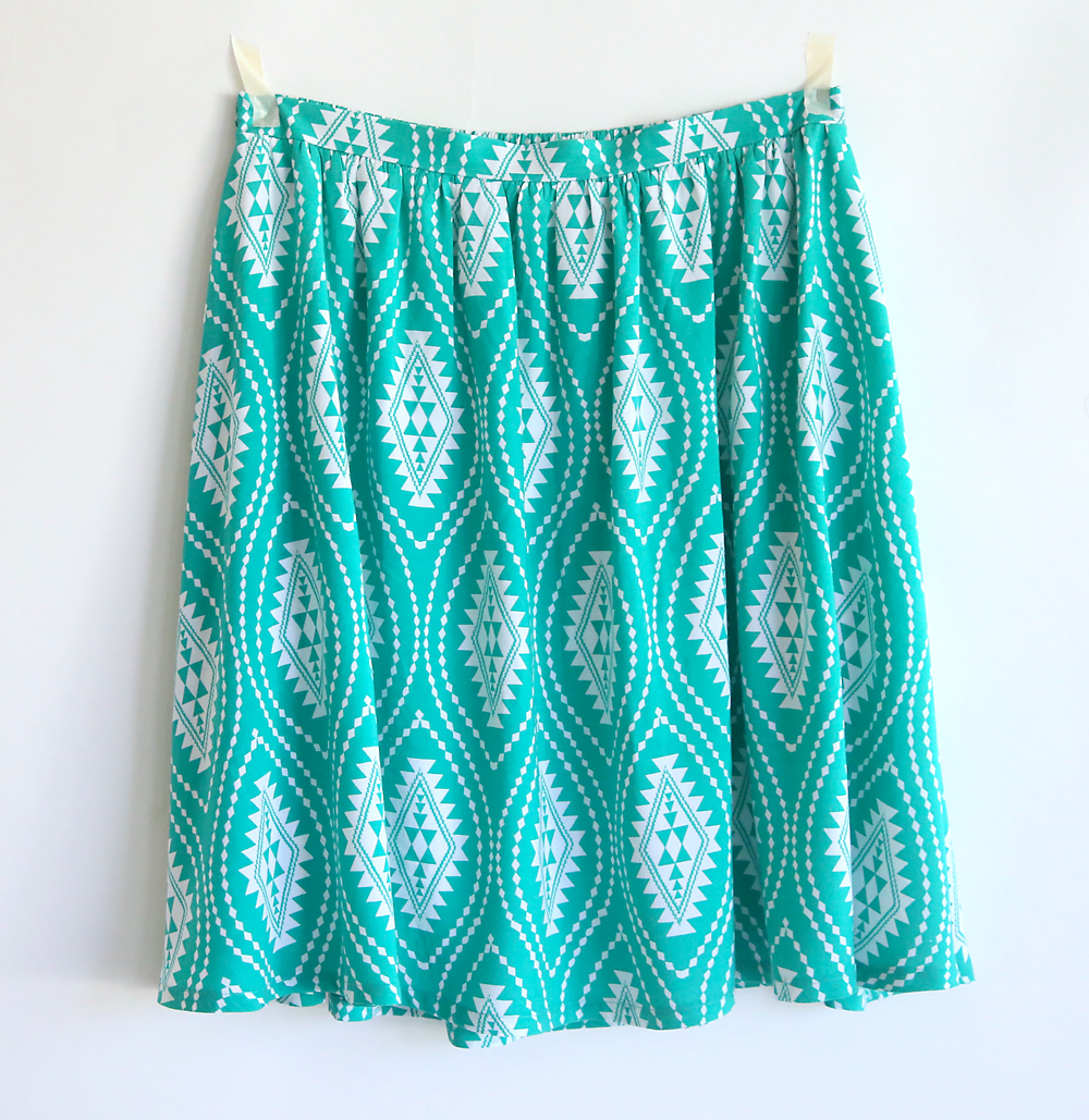 A gathered skirt hanging on a wall