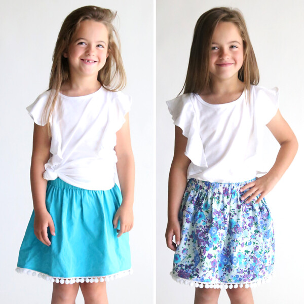 A girl wearing a reversible skirt that's blue on one side and floral on the other