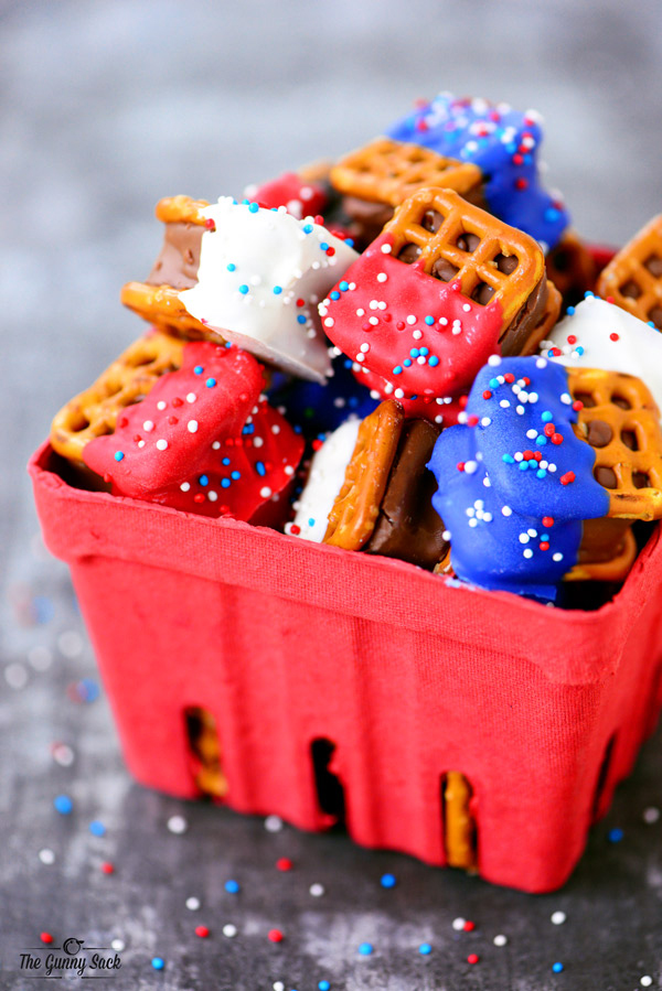 Caramel pretzel sandwiches dipped in red, white and blue candy coating with sprinkles